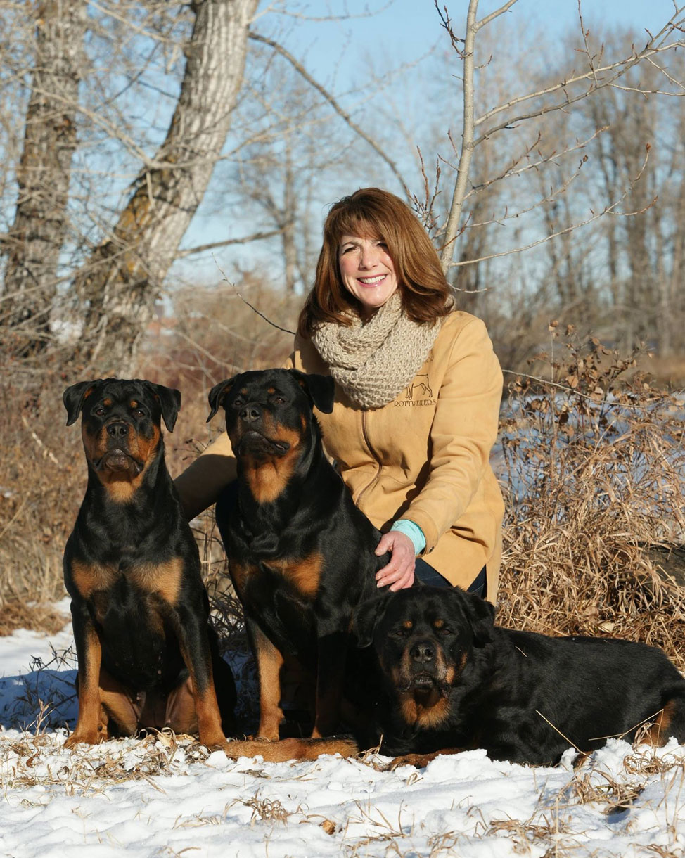 gwen with her Rottweilers